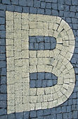 Sidewalk made of stones with letters — Stock Photo