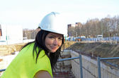 Young female architect at the construction site of the construct — Foto Stock