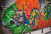 Graffiti of unidentified artist on the wall — Stock Photo