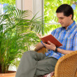 Man enjoying a book at home — Stock Photo