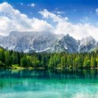Beautiful lake with mountains in background — Stock Photo #20087151
