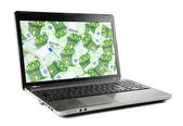 Euro banknotes on laptop display — Stock Photo