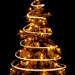 Christmas tree with light spiral drawn around it — Stock Photo