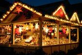 Illuminated Christmas fair kiosk — Stock Photo