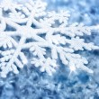 Blue background with ice and a large snowflake — Stock Photo