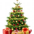 Lush Christmas tree with gift boxes — Stock Photo