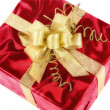 Red gift box with smart gold bow — Stock Photo