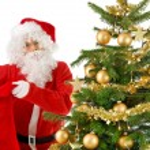 Santa Claus reaching into his bag — Stockfoto