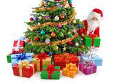 Santa preparing the gifts — Stock Photo