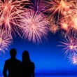 Couple enjoying a fireworks display — Stock Photo