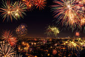 Whole city celebrating with fireworks — Stock Photo