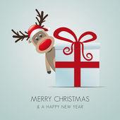 Reindeer christmas gift box red ribbon — Stock Photo