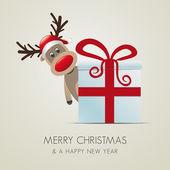 Reindeer behind gift box — Stock Photo