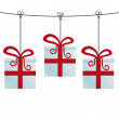 Gift boxes hanging on a twine — Stock Photo