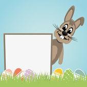 Easter bunny behind signboard — Stock Vector