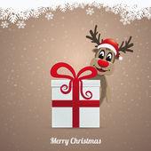 Reindeer winter landscape behind gift — Stock Photo