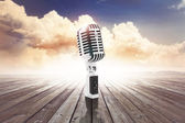 Vintage microphone on  wooden surface — Stockfoto