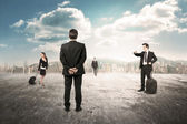 Business managers rendezvous in desert city — Stock Photo