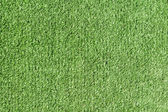 Background texture with fake grass — Stock Photo