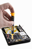 Repair tablet. Hand with screwdriver . — Stock Photo