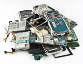 Broken cell phones, dumped a bunch. — Stock Photo