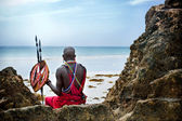 Maasai sitting by the ocean — Stock Photo