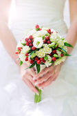 Bridal bouquet in hands — Stock Photo
