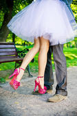 Legs of the groom and the bride. — Stock Photo