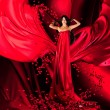 Goddess of love in red dress and hearts — Stock Photo