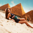 Attractive woman in egypt on pyramid background - Zdjęcie stockowe