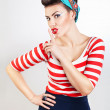 Funny pin-up woman says quiet — Stock Photo