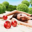 Woman with red apples — Stock Photo