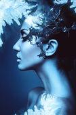 A winter woman head profile with splash — Stock Photo