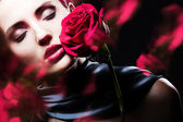 Attractive woman with rose — Stock Photo