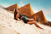 Attractive woman in egypt on pyramid background — Stock Photo