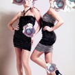 Two sexy girls with big cabbage hairstyle — Stock Photo #14057303