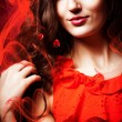 Womin red dress around red fabric — Stock Photo #14057339