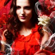 Beautiful hot brunette womin love in red dress around red fab — Stock Photo #14057399