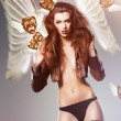 Beautiful erotic sexy woman with wings and flying masks — Stock Photo #14057763