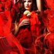 Beautiful hot brunette womin love in red dress around fabric — Stock Photo #14058726