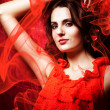 Beautiful womin love in red dress around fabric — Stock Photo #14058743