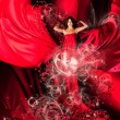 Goddess of love in red dress with long hair and hearts — Photo