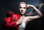 Aggressive blonde woman in red — Stok fotoğraf