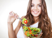 Happy healthy woman with salad on fork — Stock Photo