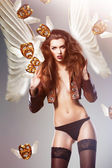 Beautiful erotic sexy woman with wings and flying masks — Stock Photo