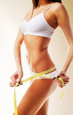 Beautiful woman body in white with yellow measure — Stock Photo