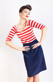 Interesting cute woman in striped t-shirt and skirt — Stock Photo