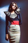 Sensual brunette woman in jacket with laces and skirt — Stock Photo