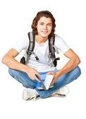 Student mit einem lehrbuch und ranzen — Stockfoto