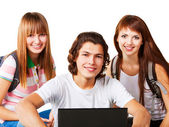 Studenten, die lächelnd mit rucksack und laptop — Stockfoto